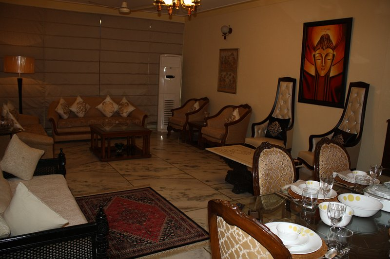 Fully furnished living and dinning room with subtle colors to enhance the comfort and beauty.