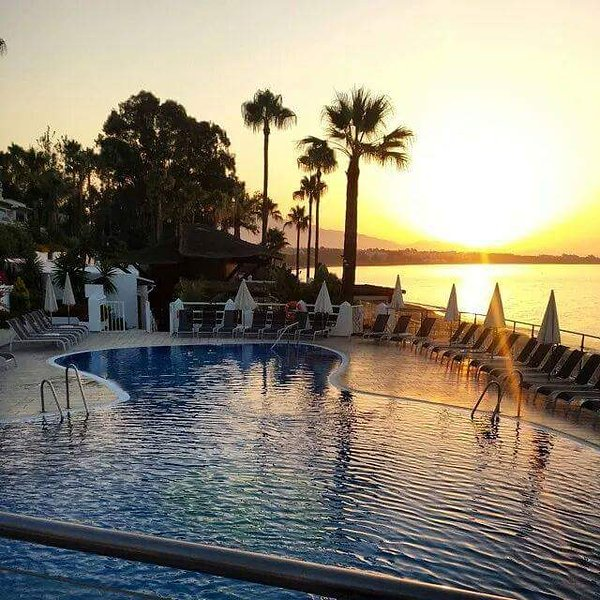 Sunrise at the beach pool
