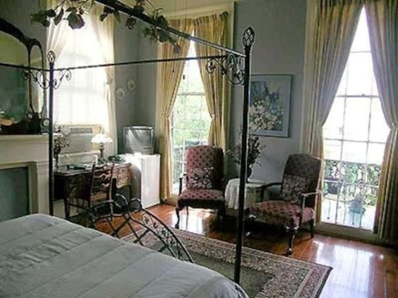 View from right side of king sized bed, facing the balcony overlooking Royal St.