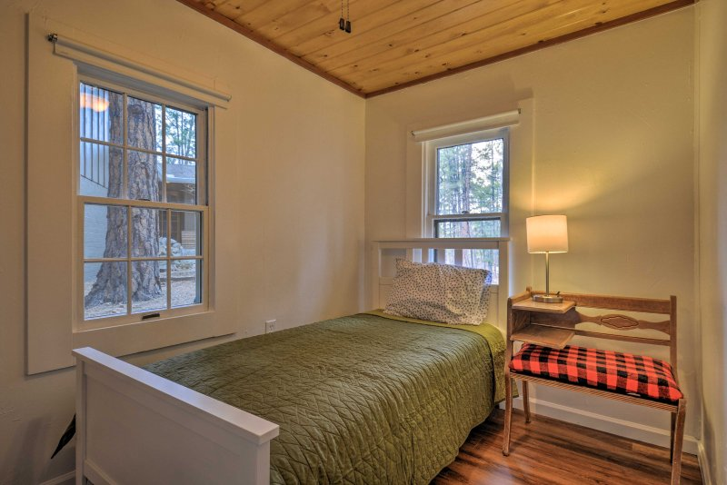 The second bedroom hosts a plush twin bed.