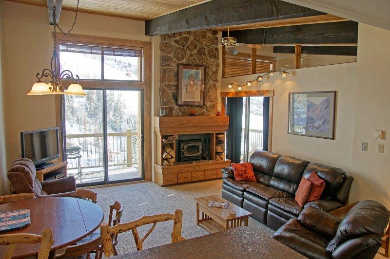 Leather furniture, wood burning fireplace