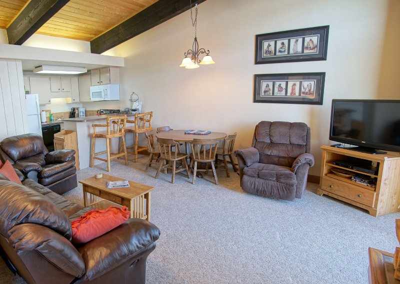 Open concept kitchen, living, & dining room