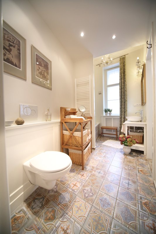 Full bathroom with concealed washer and dryer