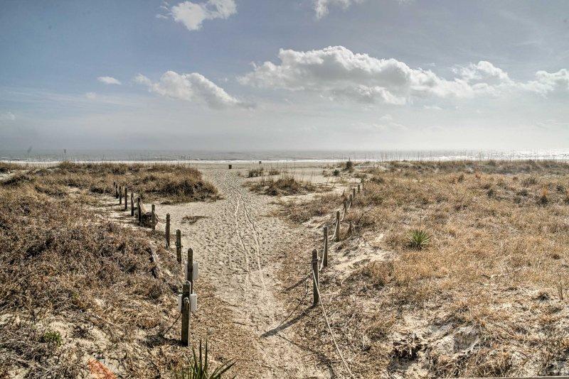 This beachfront condo boasts multiple access points to the pristine shoreline.