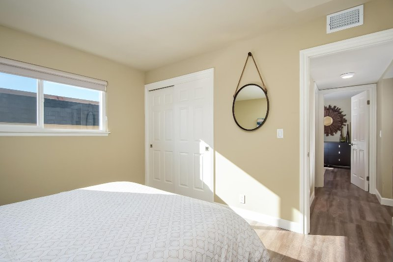Dresser and closet space are also provided in the second bedroom.