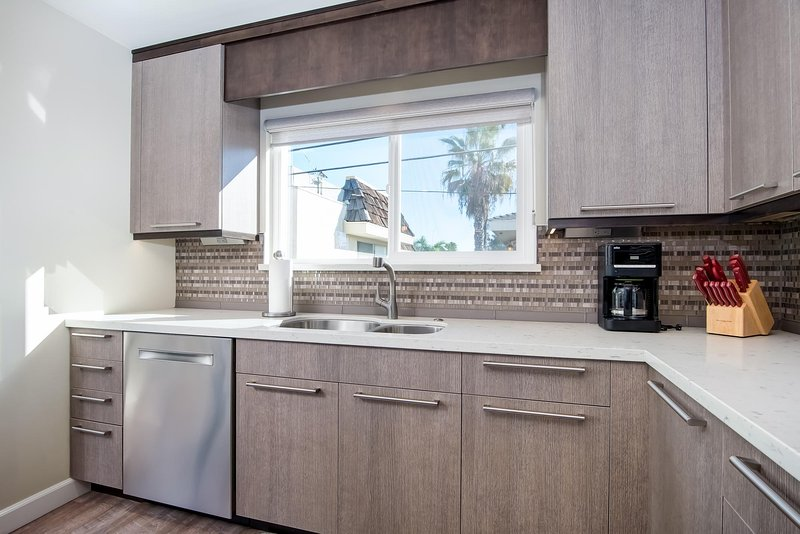 You'll find everything you need to cook and dine in this stunning modern kitchen.