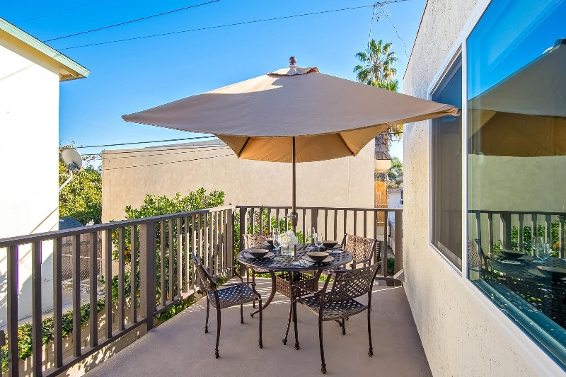 The balcony includes a shaded dining area for 4.