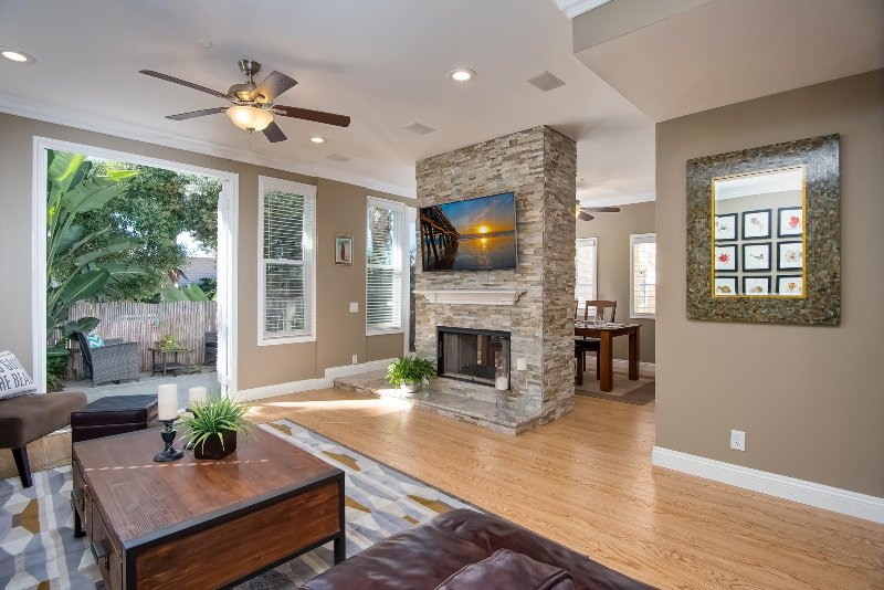 The living room connects to the private ground floor patio through French doors.