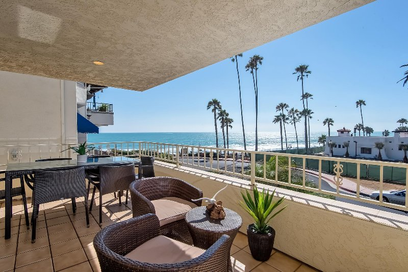 Ocean view balcony includes a dining table for 6, a grill, and additional outdoor seating to enjoy the ocean air!