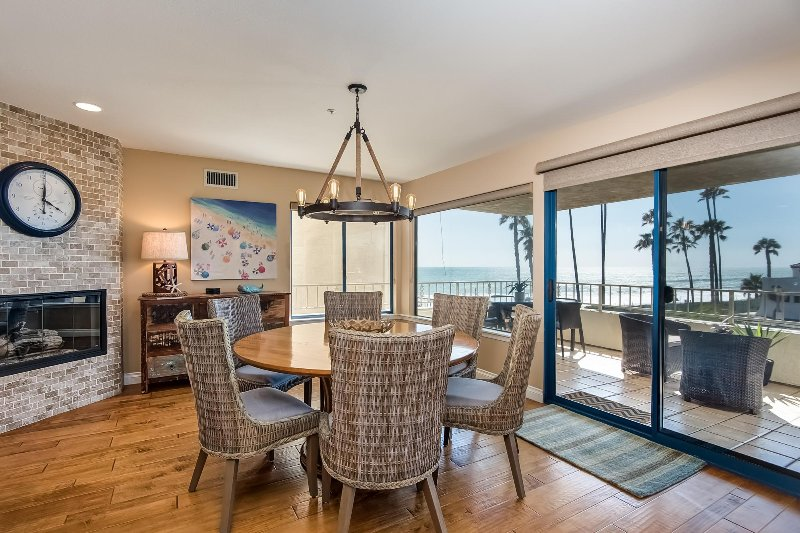 Ocean views all day long! Fireside dining room seats 6 with ocean views and doors onto the balcony.