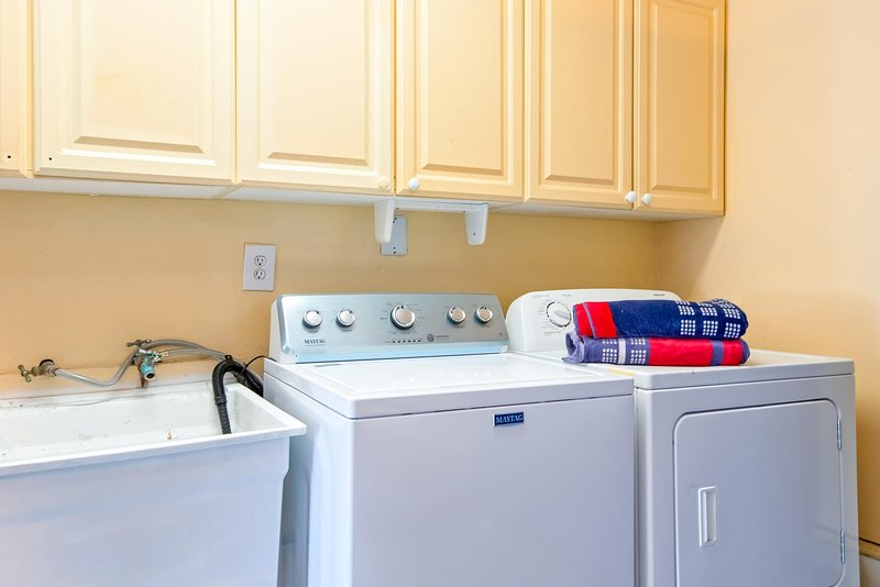 This coastal cottage also includes a laundry room with washer and dryer.