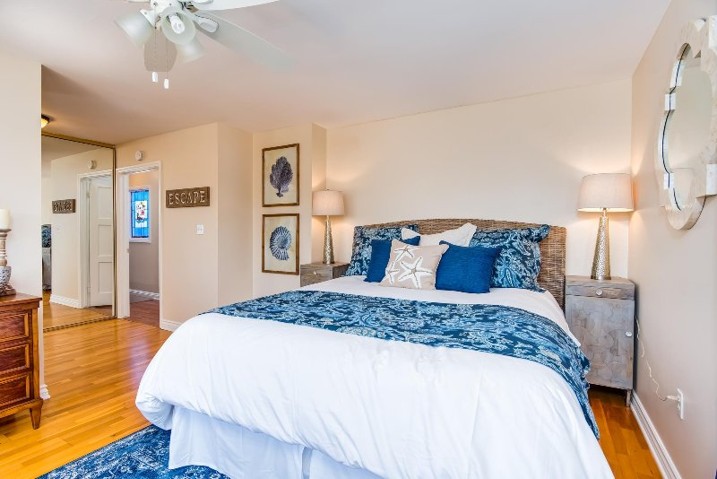 Master bedroom includes king bed, ceiling fan, and private bathroom.