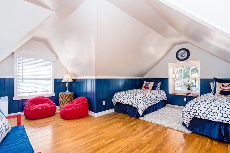 The fourth bedroom is a fun spacious room with peaked ceilings and a sitting area.