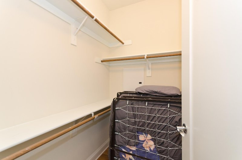 Walk in closet with roll away bed