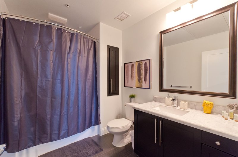 Bathroom with stand up shower and tub