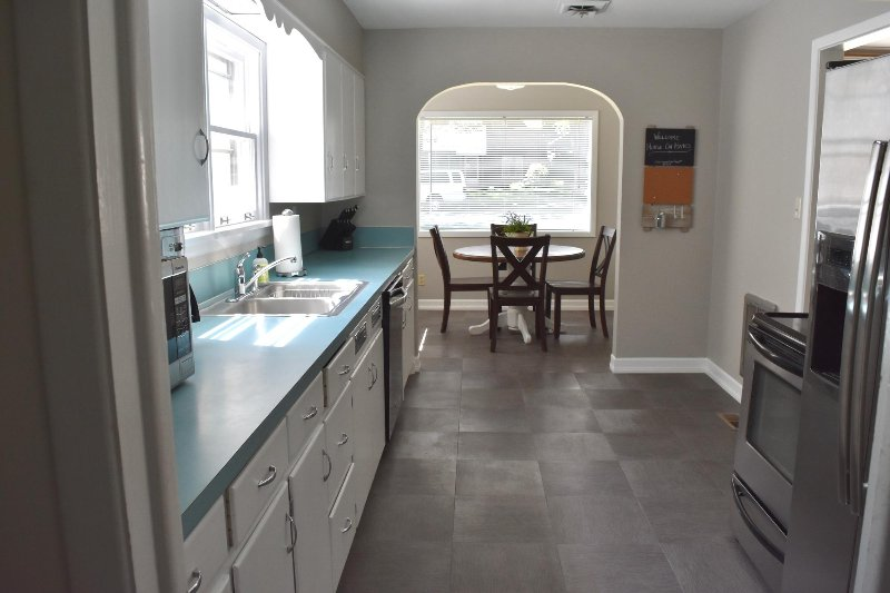 Wide galley style kitchen w/ sun-filled breakfast nook