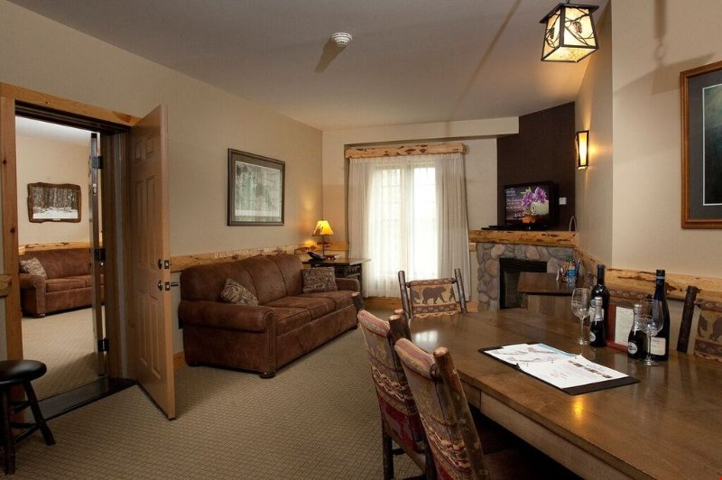 Relax in the beautiful open living room with your group and warm up in front of the fireplace