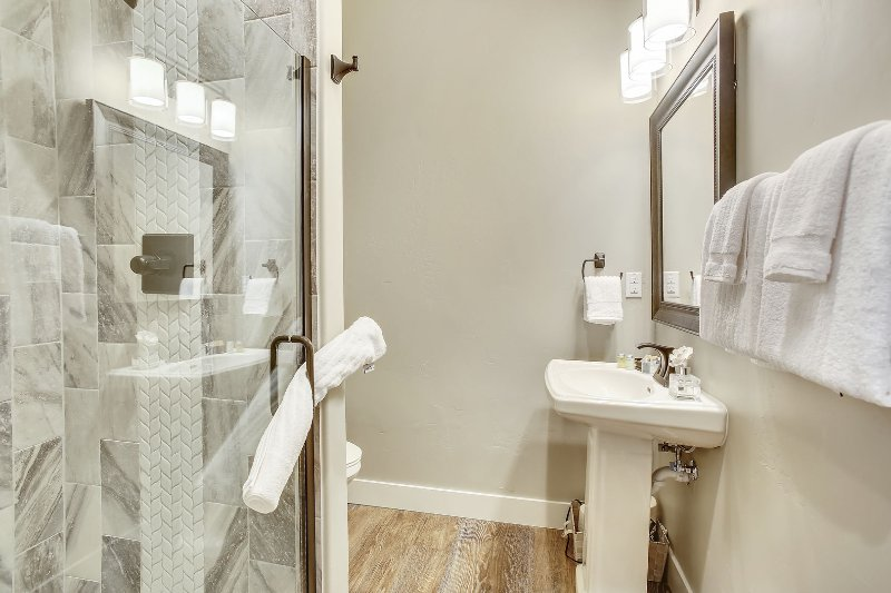 Beautiful full bathroom on main level with custom stone shower.