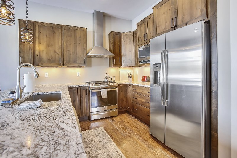 Large custom gourmet chef's kitchen with professional upgraded appliances.