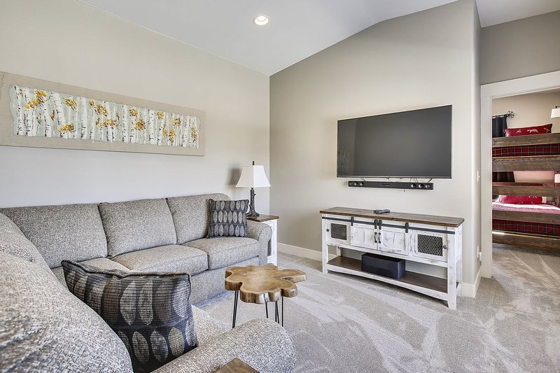 Large upper level entertainment area with 60' HDTV home theatre.