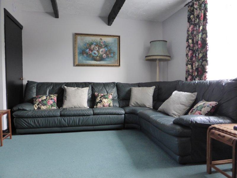 Corner sofa in L-shaped living room.