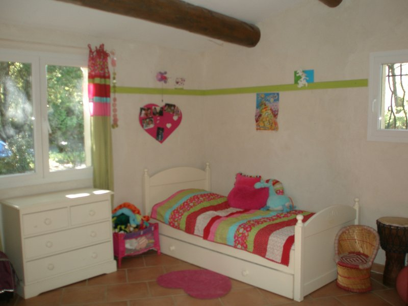 bedroom with queen and single beds