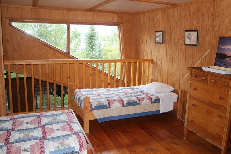 West loft with view of Moose Lake...not the low ceiling loft you may have imagined...