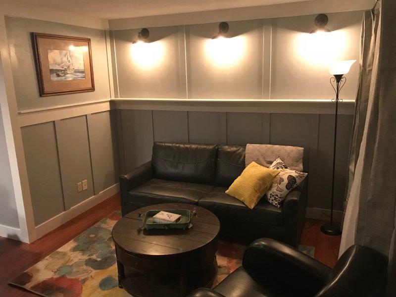 Living room with sofa sleeper.