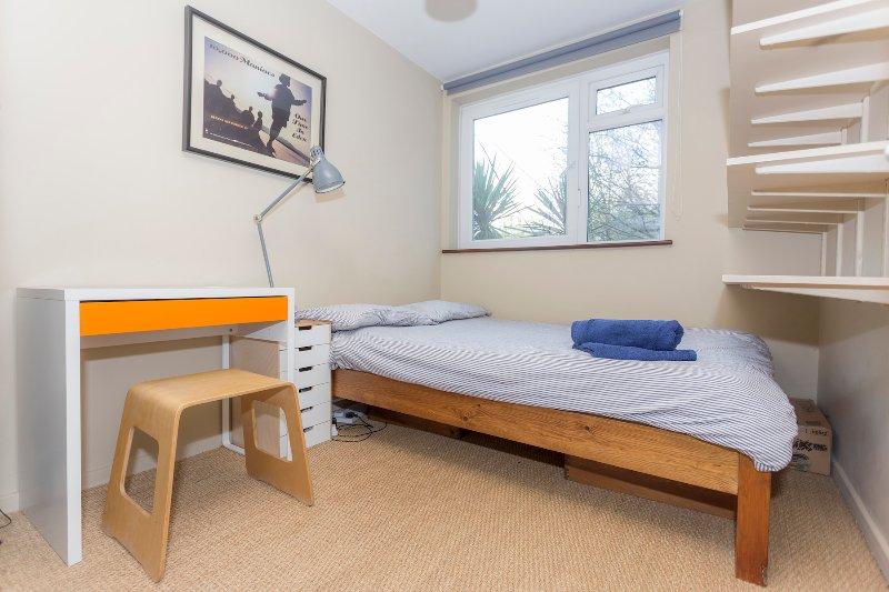 Tres dormitorio