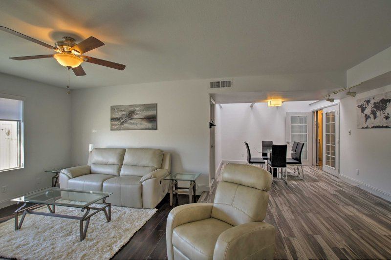 The home's open floor plan allows the living room to flow seamlessly in to the dining room.