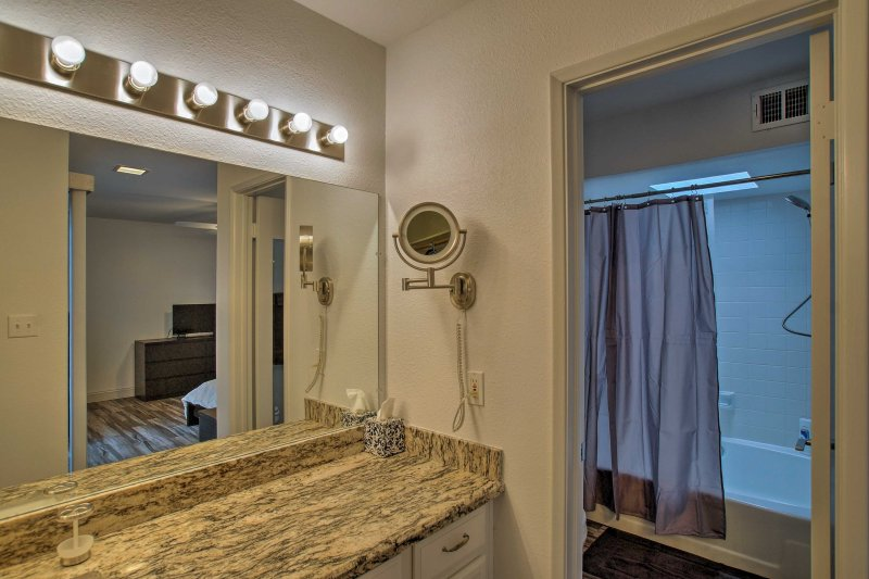 With a large granite vanity, the master bathroom is a great place to prepare for a night in Old Town Scottsdale.