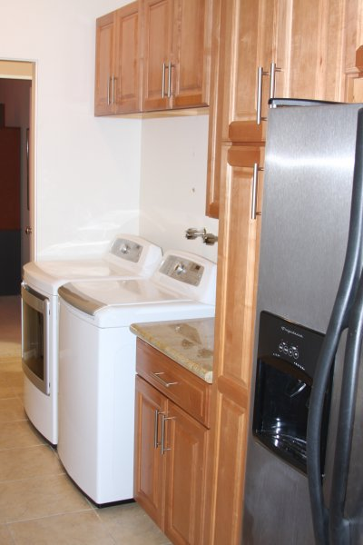 Laundry area with new wash and dryer