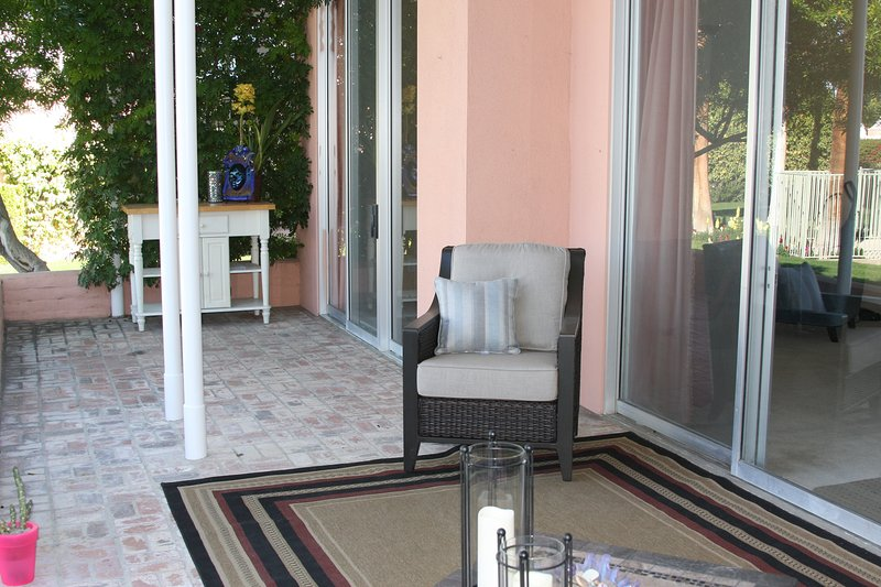 Back deck & patio with new Sunbrella furniture,