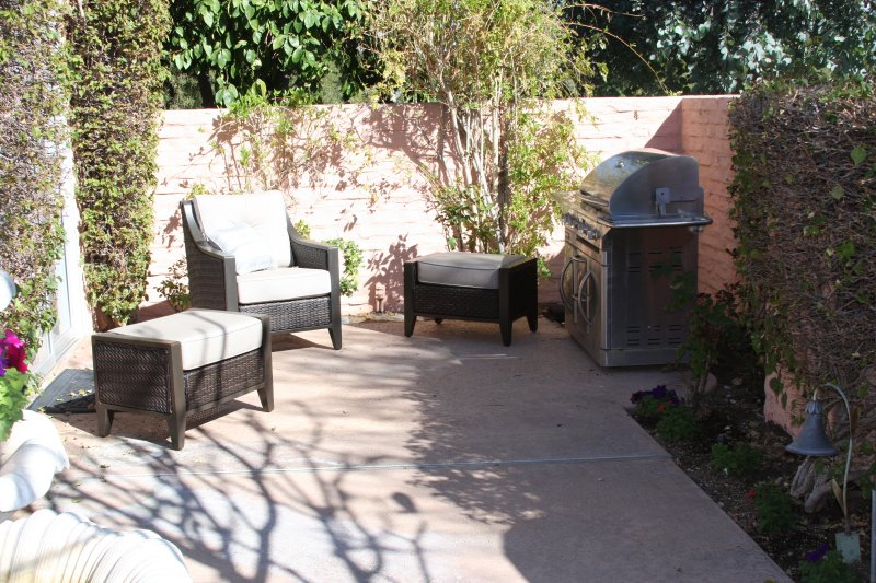 Front patio/courtyard with large stainless steel barbecue and new Sunbrella patio furniture