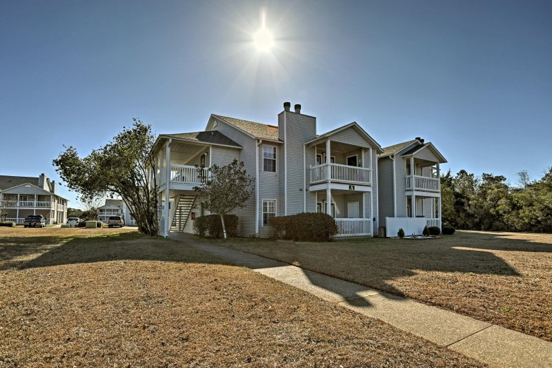 The condo offers tons of community amenities including a pool and grill area!