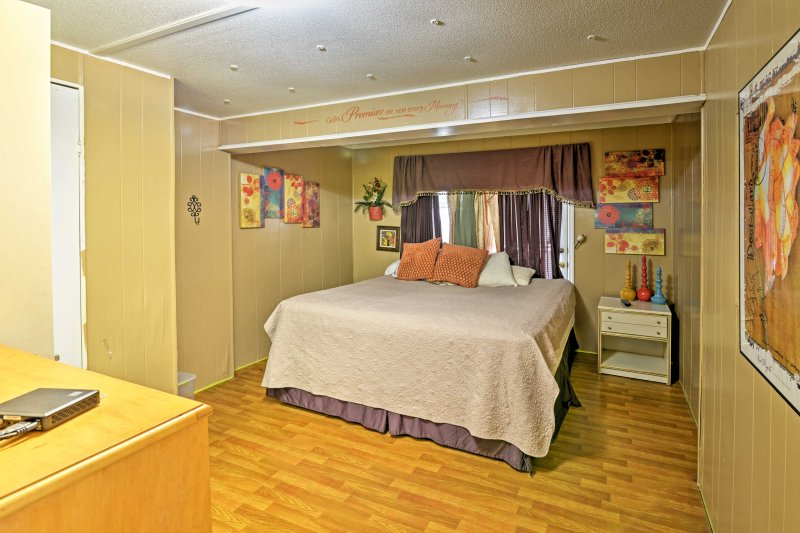 You'll find a king bed in the first master bedroom.