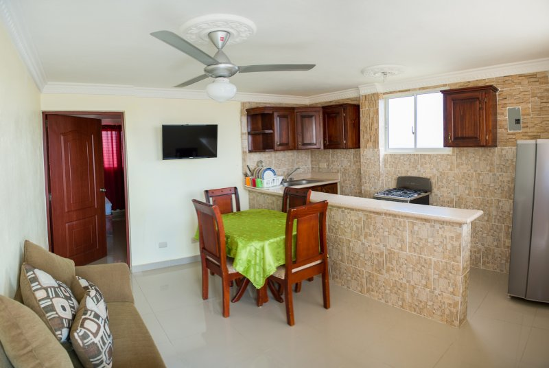 Fully furnished dining/seating area with full kitchen