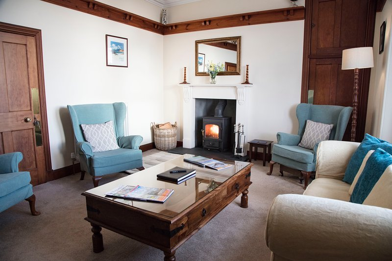 Snug sitting room with lovely wood burner to make you extra cosy. Board games, books and TV too.