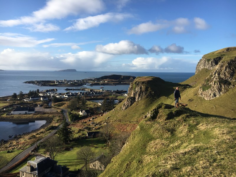 Dog walking in the hills above Ellenabeich and Easdale Island