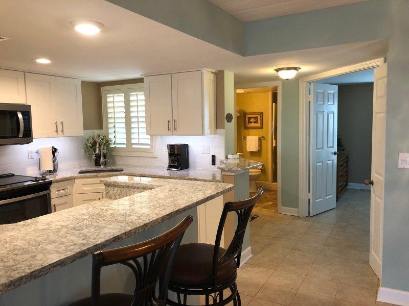 Kitchen with bar Quartz countertops.