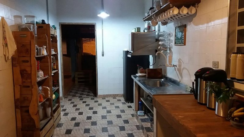 kitchen with stove, oven, freezer, refrigerator and utensils.