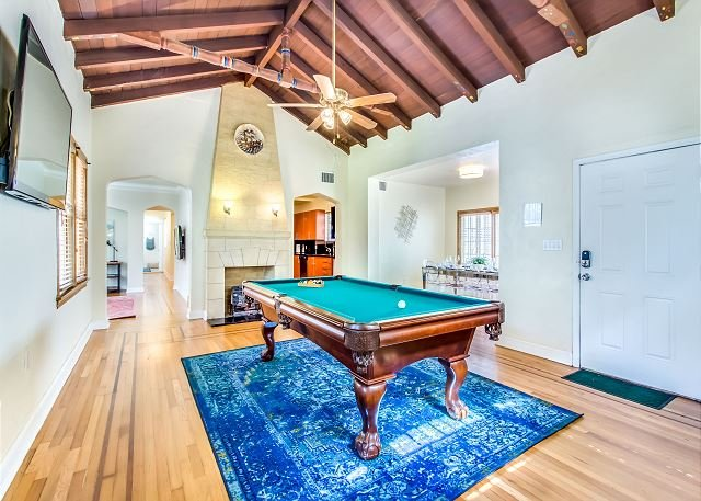 Great room with pool table and 60-inch TV