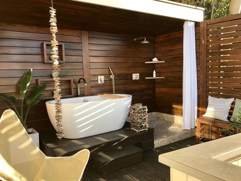 Spa deck off master suite features ocean view soaking tub and shower