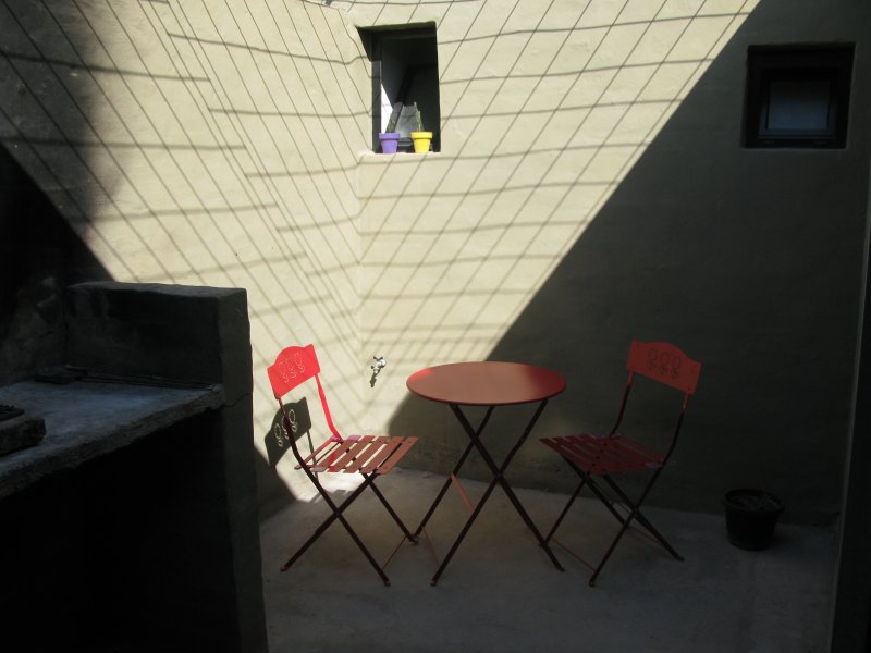 Patio interno con parrilla