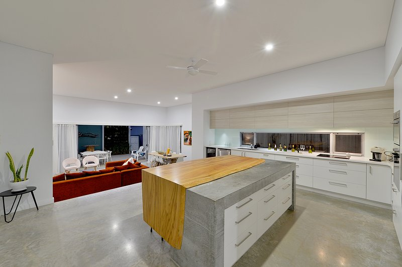 Stunning gourmet kitchen with solid timber and polished concrete Island