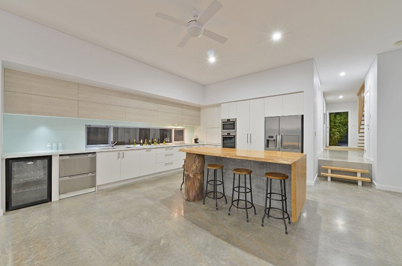 Exquisite kitchen with huge concrete and timber island to hang around and chat with a glass of wine