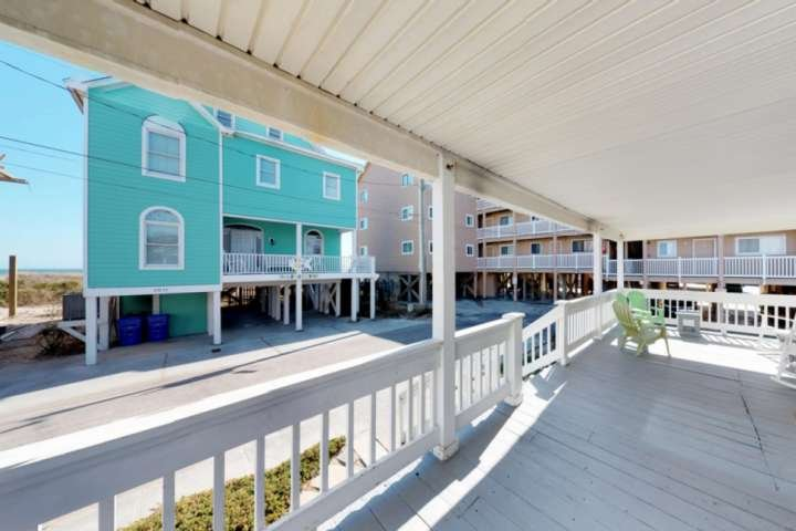 The large porch is close enough to the beach to hear the waves crashing.  You also have partial views of the ocean.