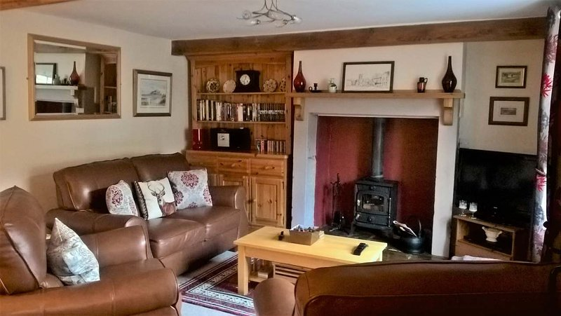 The cosy sitting room with multi fuel burner