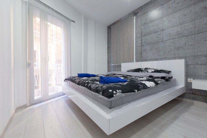 A comfy queen-sized bed await you in this bedroom and it has a private closet