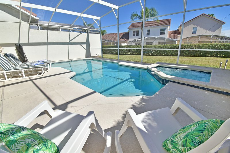 Pool and Jacuzzi with sun loungers and rocking chairs